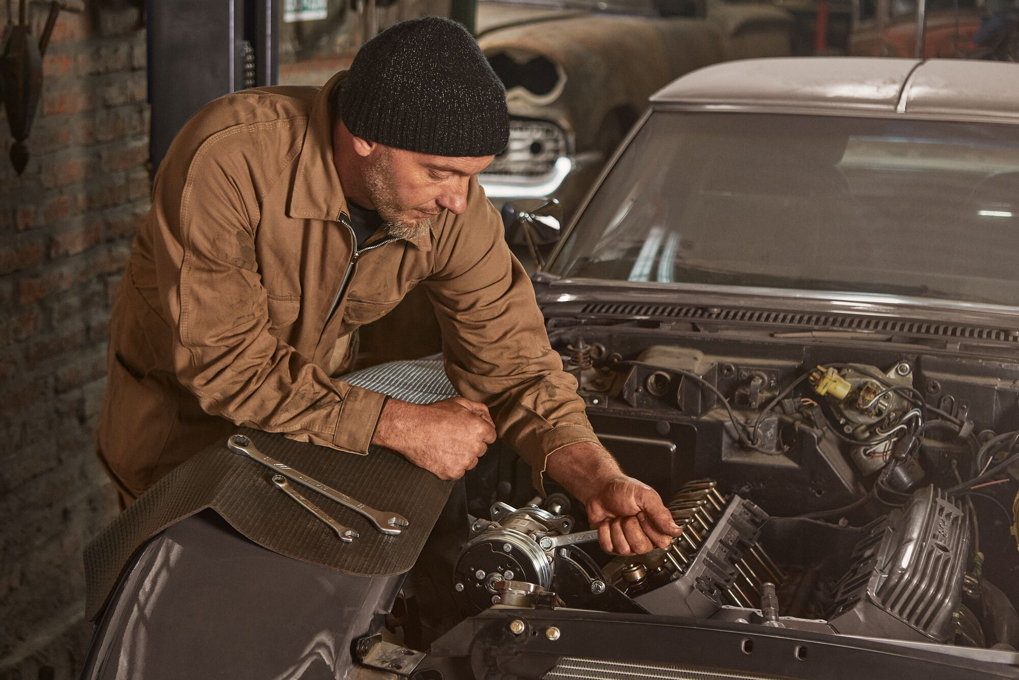 A mechanic using a STANLEY Antislip Wrench on a car's engine