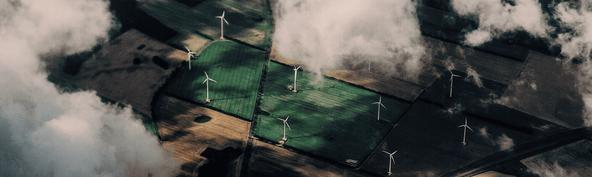 Field with wind turbine look from above.