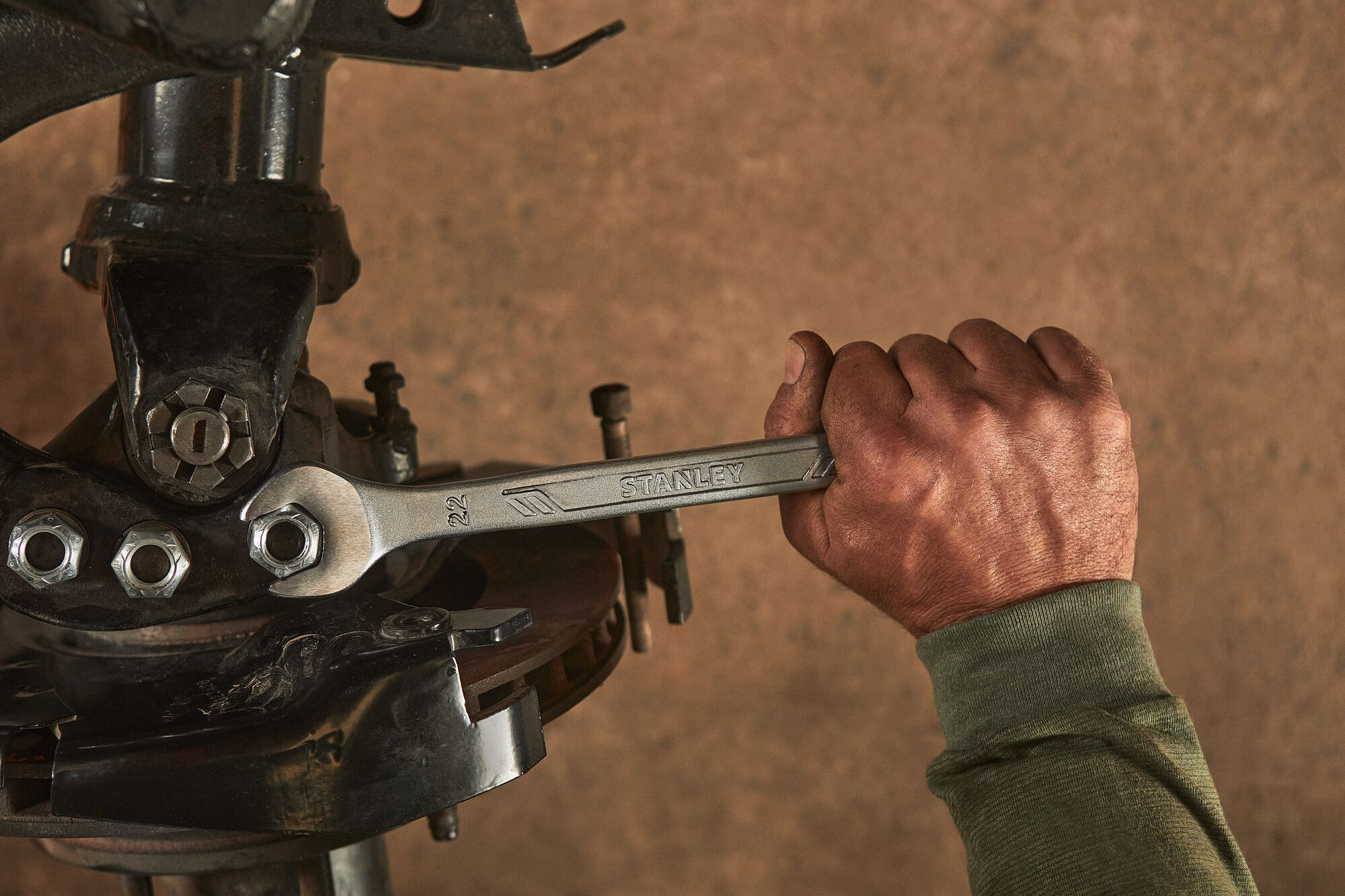 Close up of mechanic using a STANLEY Antislip Wrench on a car's engine